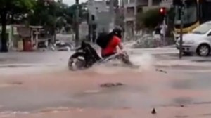 Motorcyclist rides straight into pothole