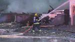 Raw Video: Fire destroys homes under construction north of Toronto