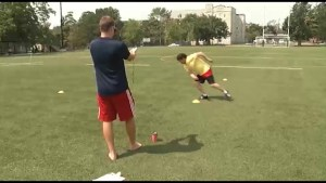 Bill Welychka trains with the Queens Gaels Football Team.