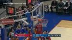 Boy climbs basketball hoop at U.S. college game to retrieve stuck ball