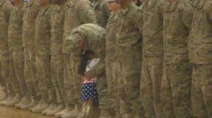 Little girl races across gym floor to embrace father returning from military tour