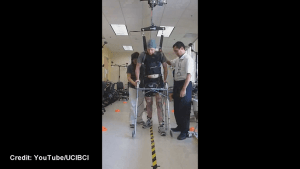 University researchers help a paralyzed man walk again with help of new brain-computer interface technology