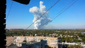 Smoke rises over army munition factory after blast in Ukraine