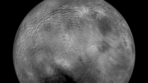 Flying over Pluto's largest moon, Charon