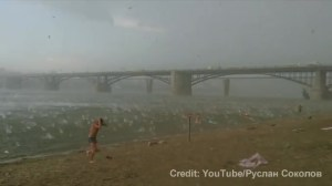 Viral video: Sudden hail storm has beach goers running for cover