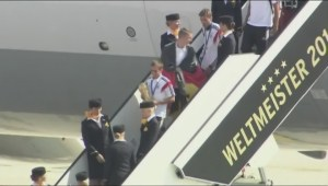 World Cup champs return home