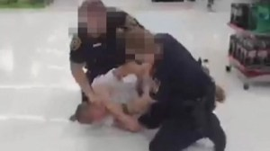 Cops caught on camera beating suspect in Walmart arrest
