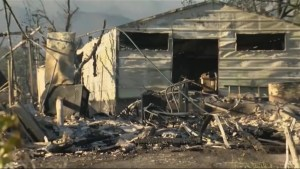 Deadly wildfire burns houses in California
