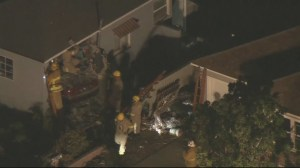 1 dead, 8 injured after car plows into house in Los Angeles