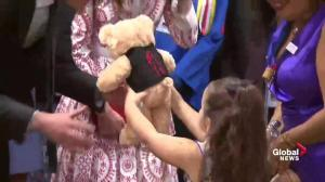 Little girl gives Will and Kate stuffed teddy bears during tour of Sheway House in east Vancouver