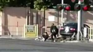 Dramatic footage captures officer pull man from car moments before train hits