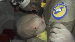 Syrian 'White Helmet' cries after rescuing baby from rubble