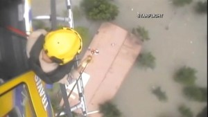 Caught on camera:  Rescuers airlift flood victims in Texas via helicopter
