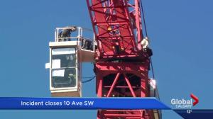 Man in custody after climbing crane in downtown Calgary: police