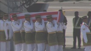 Ceremony held as coffins carrying victims of Flight MH17 are returned to Malaysia