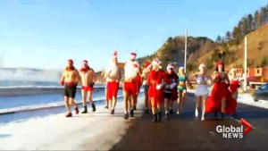 Siberians take part in Santa Claus bikini run along frozen lake