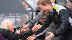 Prince Harry reunites with 97-year-old fan in the pouring rain