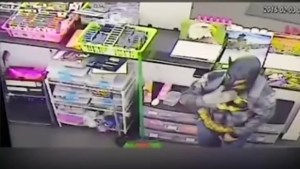 Caught on camera: 'Batman' robs California dollar store