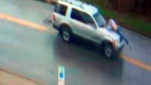 Knife-wielding man clinging to SUV caught on camera