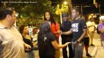 Man giving out free hugs in Charlotte gets confronted by angry protesters