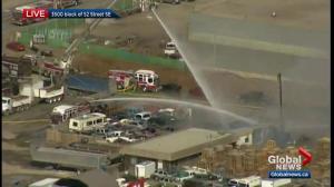 Calgary firefighters battle blaze at commercial scrap yard