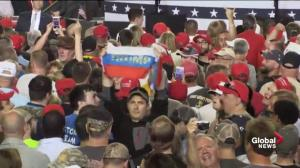 Russian flags with 'Trump' written on them held up at Trump rally