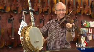 Edmonton fiddle legend playing a happy tune after instruments returned