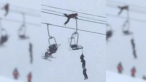 Man climbs Colorado ski lift to rescue unconscious friend dangling by neck