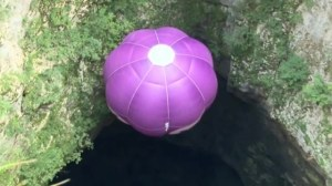 Man pilots hot air balloon into underground cave