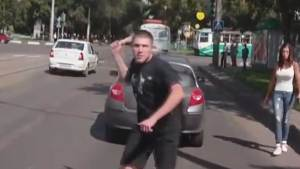 Russian road rage footage shows man threaten with axe and gun