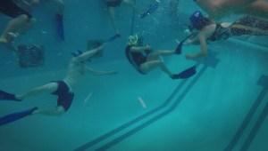 Manitobans diving into unique sport of underwater football