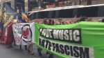 Demonstrators march in Berlin to support Germany's migrant and refugee policy