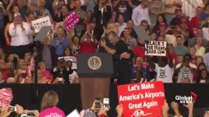 Trump brings supporter up on stage during rally in Florida