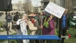 Health care workers protest anniversary of cuts at rally