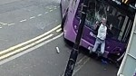 British man walks away after out-of-control bus plows into him