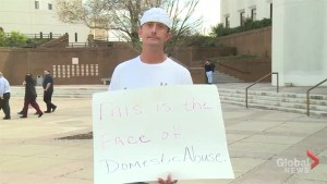 Judge sentences man to wear sign reading 'This is the face of domestic abuse'