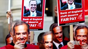 Bank of England workers don Mark Carney masks  as 1st strike in more than half century begins
