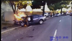 Cops rescue woman in burning car