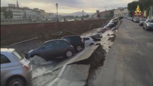 200-metre-long sinkhole along Florence's Arno River swallows dozens of cars