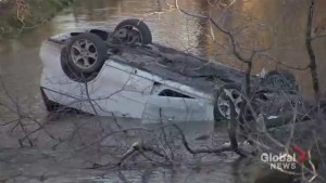 One person dead after vehicle flips into river