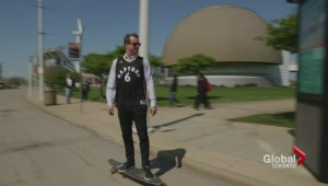 Alan Carter longboards through Cleveland