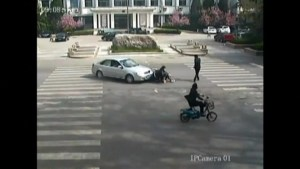 Footage of two men run over by a car in China
