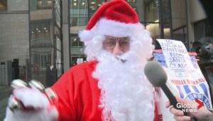 Santa gives Julian Fantino a lump of coal for Christmas