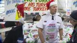 Hundreds wait for Honest Ed's annual turkey giveaway