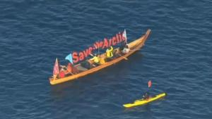 Environmental protesters try to block movement of Arctic oil rig