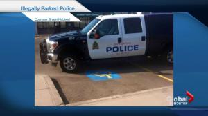 Edmonton officer ticketed for double-parking police vehicle in handicap stall