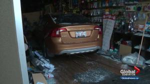 Close call in south Edmonton as car slams into business