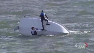 Sailors battle wind and waves to right capsized sailboat in Toronto Harbour
