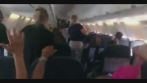Armed police direct passengers on Sunwing plane to put hands up and heads down