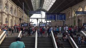 Budapest train station opens to migrants but no trains leaving Hungary